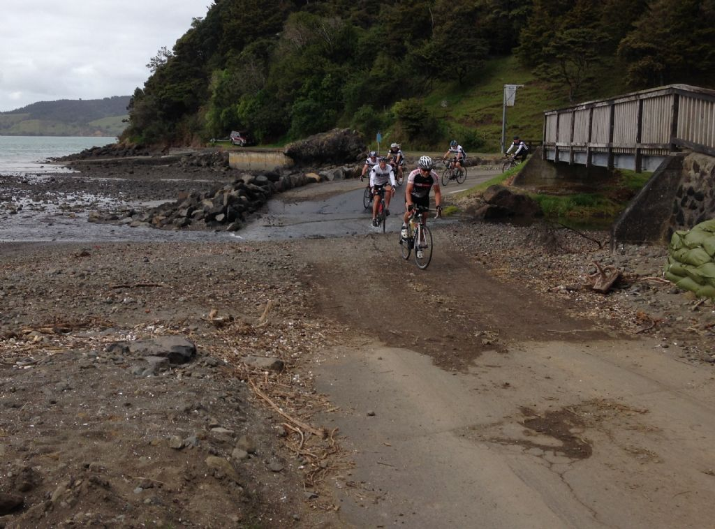 A group of NZC Riders cross the ford at Whatipu